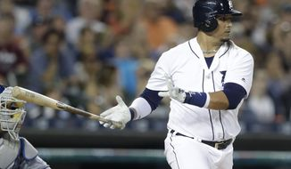 Detroit Tigers designated hitter Victor Martinez hits a two-run RBI during the seventh inning of a baseball game against the Kansas City Royals, Friday, July 15, 2016 in Detroit. (AP Photo/Carlos Osorio)