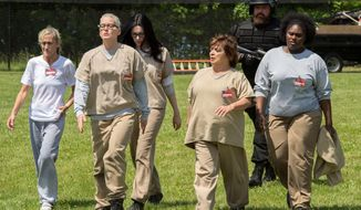 "In this image released by Netflix, Constance Shulman, from left, Lori Petty, Laura Prepon, Brad William Henke, background,  and Danielle Brooks, right, appear in a scene from, ""Orange is the New Black."" (JoJo Whilden/Netflix via AP)"