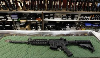 "In this July 26, 2012, file photo, an ""AR-15 style"" rifle is displayed at the Firing-Line indoor range and gun shop in Aurora, Colo. Baltimore police officers responding to the sound of gunshots near an apartment building fatally shot a man who fired at them with an ""AR-15-style"" gun, a police spokesman said early Friday, July 15, 2016. No officers were injured in the incident, spokesman T.J. Smith said. (AP Photo/Alex Brandon, File)"