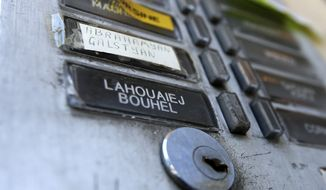 The plate of the interphone shows the name of Mohamed Lahouaiej Bouhlel outside the building where he lived in Nice, southern France, Saturday, July 16, 2016. The man responsible for turning a night of celebration into one of carnage in the seaside city of Nice was a petty criminal who hadn't been on the radar of French intelligence services before the attack.  (AP Photo/Luca Bruno)