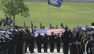 Members of an honor guard salute as the flag is lifted off of the coffin holding slain Dallas police officer Patrick Zamarripa during a ceremony at Dallas-Fort Worth National Cemetery in Dallas, Saturday, July 16, 2016. Zamarripa was one of five officers killed last week by a lone gunman during a protest march in Dallas. (AP Photo/LM Otero)