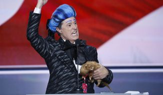 Comedian Stephen Colbert clowns around on the stage at the Republican National Convention in Cleveland, Sunday, July 17, 2016. (AP Photo/J. Scott Applewhite)