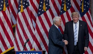 Republican presidential candidate Donald Trump, right, and Gov. Mike Pence, R-Ind., shake hands during a campaign event to announce Pence as the vice presidential running mate on, Saturday, July 16, 2016, in New York. In their first joint appearance, Trump tried to draw a sharp contrast between Pence, a soft-spoken conservative, and Hillary Clinton, the Democratic presidential candidate. (AP Photo/Mary Altaffer)
