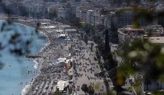 View of the famed Promenade des Anglais scene of the Thursday's attack in Nice, southern France, Sunday, July 17, 2016 three days after a truck mowed through revelers. French authorities detained two more people Sunday in the investigation into the Bastille Day truck attack on the Mediterranean city of Nice that killed at least 84 people, as authorities try to determine whether the slain attacker was a committed religious extremist or just a very angry man.(AP Photo/Francois Mori)