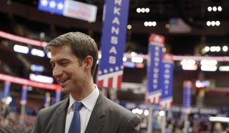 U.S. Sen. Tom Cotton, R-Ark., talks to a reporter on the floor of the Republican National Convention, Sunday, July 17, 2016, in Cleveland. (AP Photo/John Locher) ** FILE **