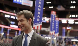 U.S. Sen. Tom Cotton, R-Ark., talks to a reporter on the floor of the Republican National Convention, Sunday, July 17, 2016, in Cleveland. (AP Photo/John Locher)