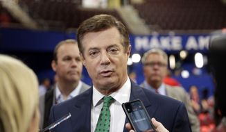 Trump Campaign Chairman Paul Manafort talks to reporters on the floor of the Republican National Convention at Quicken Loans Arena, Sunday, July 17, 2016, in Cleveland. (AP Photo/Matt Rourke) ** FILE **
