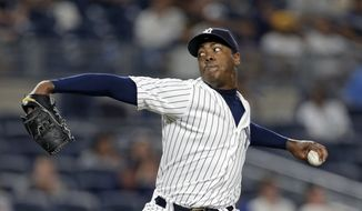 New York Yankees relief pitcher Aroldis Chapman delivers a pitch during the ninth inning of a baseball game against the Boston Red Sox on Sunday, July 17, 2016, in New York. The Yankees won 3-1. (AP Photo/Adam Hunger) **FILE**
