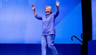 Democratic presidential candidate Hillary Clinton arrives to speak at the American Federation of Teachers convention at the Minneapolis Convention Center in Minneapolis, Monday, July 18, 2016. (AP Photo/Andrew Harnik)