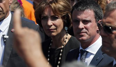 People boo French prime minister Manuel Valls, center, and Health Minister Marisol Touraine, left, after a minute of silence on the famed Promenade des Anglais in Nice, southern France, to honor the victims of an attack near the area where a truck mowed through revelers, Monday, July 18, 2016. France is holding a national moment of silence for 84 people killed by a truck rampage in Nice, and thousands of people are massed on the waterfront promenade where Bastille Day celebrations became a killing field.(AP Photo/Francois Mori)
