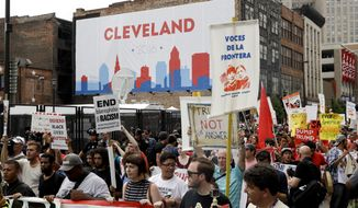 Protestors march during a rally against Republican presidential candidate Donald Trump on Monday, July 18, 2016, in Cleveland. (AP Photo/Patrick Semansky)