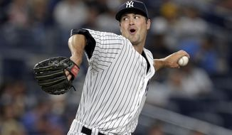 New York Yankees relief pitcher Andrew Miller (48) delivers a pitch during the eighth inning of a baseball game against the Boston Red Sox on Sunday, July 17, 2016, in New York. (AP Photo/Adam Hunger)