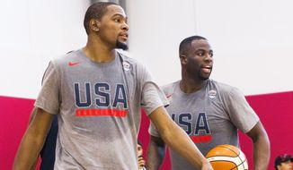 Golden State Warriors teammates Kevin Durant, left, and Draymond Green participate in shooting drills during Team USA basketball practice in Las Vegas on Monday, July 18, 2016. (Benjamin Hager/Las Vegas Review-Journal via AP)