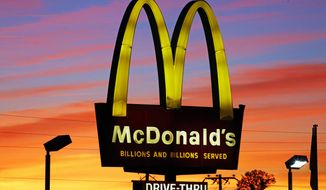 In this Saturday, Oct. 10, 2015, photo, the sun sets behind a McDonald's in Ebensburg, Pa. Starbucks and McDonalds told The Associated Press on July 18, 2016, that they're in the process of implementing technology to filter pornography from Wi-Fi connections at their stores. (AP Photo/Gene J. Puskar, File)