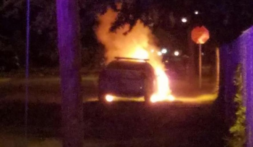 An unoccupied police cruiser was firebombed outside a Florida mosque Sunday morning and a note supporting the Black Lives Matter movement was found at the scene, police said. (Daytona Beach Police Department)