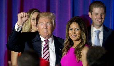 In this June 7, 2016, file photo, Republican presidential candidate Donald Trump gestures to supporters as he leaves the stage with his wife Melania after a news conference at the Trump National Golf Club Westchester in Briarcliff Manor, N.Y.(AP Photo/Mary Altaffer)
