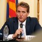 Sen. Jeff Flake, Arizona Republican, who earlier claimed he'd be home mowing his lawn rather than attending his party's convention in Cleveland, said he watched the first night on television and was dismayed at the attacks on Democrats' presumptive nominee, Hillary Clinton, including calls to jail her. (Associated Press)