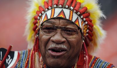 """Washington Redskins fan Zema """"Chief Zee"""" Williams cheers on his team before the NFL football game against the Kansas City Chiefs, Sunday, Oct. 18, 2009 in Landover, Md. (AP Photo/Nick Wass)"""