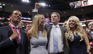 Republican Presidential Candidate Donald Trump's children Donald Trump, Jr., Ivanka Trump, Eric Trump AND Tiffany Trump celebrate on the convention floor during the second day session of the Republican National Convention in Cleveland, Tuesday, July 19, 2016. (AP Photo/Carolyn Kaster)