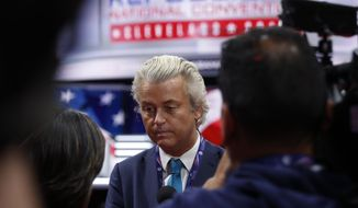 Dutch lawmaker Geert Wilders talks to reporters as he arrives at at Quicken Loans Arena before the start of the second day session of the Republican National Convention in Cleveland, Tuesday, July 19, 2016. (AP Photo/Carolyn Kaster)