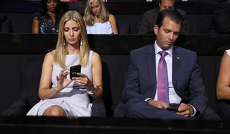 Republican Presidential Candidate Donald Trump's children Ivanka Trump and Donald Trump Jr., check on their phones during the second day session of the Republican National Convention in Cleveland, Tuesday, July 19, 2016. (AP Photo/Carolyn Kaster)