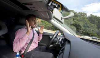 Kaushik Raghu, senior staff engineer at Audi, takes his hands off the steering wheel while demonstrating an Audi self-driving vehicle on I-395 expressway in Arlington, Va., Friday, July 15, 2016. (AP Photo/Pablo Martinez Monsivais)