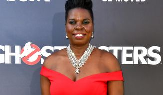 "Leslie Jones arrives at the Los Angeles premiere of ""Ghostbusters"" in this July 9, 2016 file photo. In a series of posts Monday, July 19, Jones said she had been pummeled with racist tweets. She said the messages were deeply hurtful and brought her to tears. (Photo by Jordan Strauss/Invision/AP, File)"