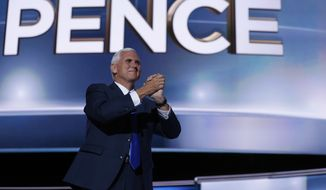Republican vice presidential candidate Gov. Mike Pence, R-Ind., gestures as he arrives on stage to deliver his acceptance speech during the third day session of the Republican National Convention in Cleveland, Wednesday, July 20, 2016. (AP Photo/Mary Altaffer)