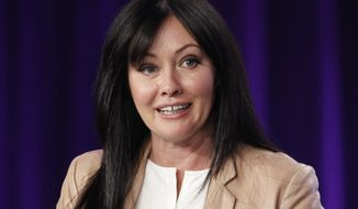Shannen Doherty participates in a panel discussion in this January 2012 file photo. It was revealed that Doherty had breast cancer in August 2015. (AP Photo/Danny Moloshok, File)