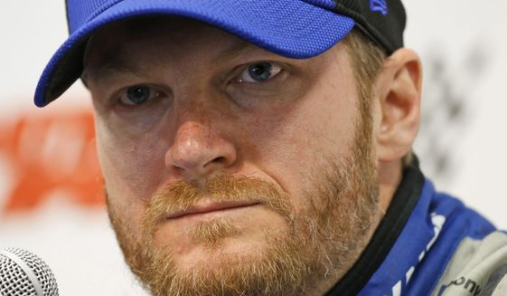 In this April 1, 2016, photo, Sprint Cup driver Dale Earnhardt Jr., speaks to the media during a press conference at the Martinsville Speedway in Martinsville, Va. Earnhardt Jr. will miss two more races as he recovers from concussion-like symptoms and retired NASCAR champion Jeff Gordon will replace him at Indianapolis and Pocono. The announcement came Wednesday, July 20, 2016, from Hendrick Motorsports, which said Earnhardt has not been cleared by doctors to drive.  (AP Photo/Steve Helber, File) **FILE**