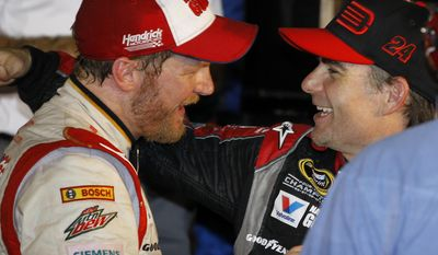In this Feb. 23, 2014, photo, Dale Earnhardt Jr., left, celebrates in Victory Lane with teammate Jeff Gordon, right, after winning the NASCAR Daytona 500 Sprint Cup series auto race at Daytona International Speedway in Daytona Beach, Fla. Gordon will get one more shot to win in Indianapolis this weekend when he replaces Earnhardt Jr. in the No. 88 car. On Wednesday, July 20, 2016, Hendrick Motorsports announced that Earnhardt would miss the next two weeks as he continues to battle balance issues and nausea. (AP Photo/Terry Renna, File)