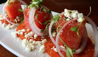 Watermelon salad with summer tomato, feta, red onion and chervil from the Seasons 52 restaurant. (Photograph by Jacquie Kubin / Special to The Washington Times)