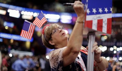 Florida delegate Kay Ragan Durden signs on the post before the start of the final day of the Republican National Convention in Cleveland on Thursday.