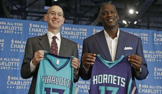 FILE - In this June 23, 2015, file photo, NBA commissioner Adam Silver, left, and Charlotte Hornets owner Michael Jordan, right, pose for a photo during a news conference to announce Charlotte, N.C., as the site of the 2017 NBA All-Star basketball game. The NBA is moving the 2017 All-Star Game out of Charlotte because of its objections to a North Carolina law that limits anti-discrimination protections for lesbian, gay and transgender people, Thursday, July 21, 2016. (AP Photo/Chuck Burton, File)**FILE**