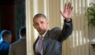 President Barack Obama waves to guest after speaking at an Eid al-Fitr reception in the East Room of the White House in Washington, Thursday, July 21, 2016. (AP Photo/Pablo Martinez Monsivais)