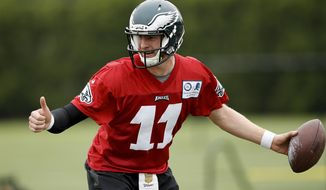 FILE - In this May 17, 2016, file photo, Philadelphia Eagles quarterback Carson Wentz practices at the team's NFL football training facility in Philadelphia. The Eagles are much closer to a rebuilding team than a contender, but they can't be completely ruled out in a weak NFC East.  (AP Photo/Matt Rourke)