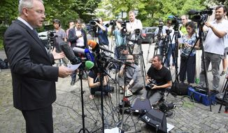 Matthieu Reeb, General Secretary of the Court of Arbitration for Sport, CAS, speaks to journalists during the release of the decision in the case between the Russian Olympic Committee (ROC), 68 Russian athletes and the International Association of Athletics Federations (IAAF) in front of the Court of Arbitration for Sport (CAS) in Lausanne, Switzerland, Thursday, July 21, 2016.  (Laurent Gillieron/Keystone via AP)