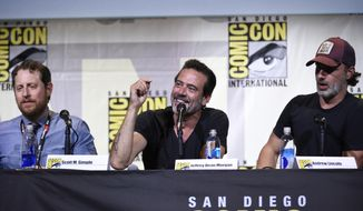 """Scott M. Gimple, from left, Jeffrey Dean Morgan, and Andrew Lincoln attend """"The Walking Dead"""" panel on day 2 of Comic-Con International on Friday, July 22, 2016, in San Diego. (Photo by Chris Pizzello/Invision/AP)"""