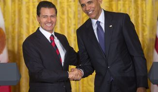 President Barack Obama and Mexican President Enrique Pena Nieto shake hands following their joint news conference in the East Room of the White House in Washington, Friday, July 22, 2016. Obama fiercely rejected Donald Trump's depiction of an America in crisis on Friday, arguing that violent crime and illegal immigration have plunged under his leadership to their lowest rates in decades.  (AP Photo/Pablo Martinez Monsivais)