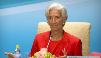 International Monetary Fund (IMF) Managing Director Christine Lagarde speaks during a press conference for the 1+6 Roundtable on promoting economic growth at the Diaoyutai State Guesthouse in Beijing, Friday, July 22, 2016. The IMF called Friday to end uncertainty over Britain's vote to leave the European Union she says is dampening global economic growth. (AP Photo/Mark Schiefelbein)