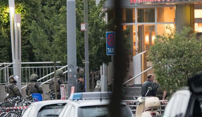 Special forces police enter the Olympia mall in Munich, southern Germany, Friday, July 22, 2016 after shots were fired. Police said that at least six people have been killed. (AP Photo/Sebastian Widmann)