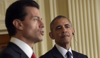 """President Barack Obama, right, listens as Mexican President Enrique Pena Nieto, left, speaks during a news conference in the East Room of the White House in Washington, Friday, July 22, 2016. Obama says he has worked to deepen the U.S. relationship with Mexico and that the two countries are not just strategic and economic partners, """"we're also neighbors and we're friends.""""   (AP Photo/Susan Walsh)"""