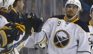 FILE - In this Dec. 26, 2015, file photo, Buffalo Sabres' Evander Kane (9) celebrates his goal during the second period of an NHL hockey game against the Boston Bruins in Boston. Buffalo police say Sabres forward Evander Kane has been charged with four counts of non-criminal harassment and one count of misdemeanor trespass after an incident at a city bar last month. Police say the 24-year-old Kane surrendered to authorities Friday, July 22, 2016,  and was issued a court appearance ticket. Investigators say two women accused Kane of grabbing them at a bar on June 24. (AP Photo/Michael Dwyer, File)
