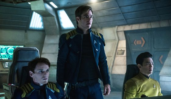"In this image released by Paramount Pictures, from left, Anton Yelchin, Chris Pine and John Cho appear in a scene from, ""Star Trek Beyond."" The movie releases in the U.S. on July 22, 2016. (Kimberley French/Paramount Pictures via AP)"