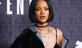 """FILE - In this Feb. 12, 2016 file photo, Rihanna attends the JFENTY PUMA by Rihanna fashion show in New York. Rihanna is checking into the final season of """"Bates Motel"""" as Marion Crane. The cast and crew of the A&E drama announced at San Diego Comic-Con International on Friday, July 22, 2016, that the singer-actress will be joining them to portray the role originated by Janet Leigh in the original film version of """"Psycho."""" (Photo by Andy Kropa/Invision/AP, File)"""