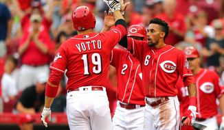 Cincinnati Reds ' Joey Votto reacts with Billy Hamilton after hitting a three-run home run off Arizona Diamondbacks' Archie Bradley in the first inning of a baseball game, Friday, July 22, 2016, in Cincinnati. (AP Photo/Aaron Doster)