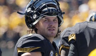 FILE - In this Sept. 19, 2015, file photo, Missouri quarterback Maty Mauk watches from the sideline as his team plays Connecticut in the second quarter of an NCAA college football game in Columbia, Mo. Mauk understands that second-guessing might accompany his second chance at Eastern Kentucky. But following a tumultuous junior season at Missouri, the quarterback is looking forward to a fresh start with the Colonels. Mauk was suspended three times in four months before being dismissed in January by new Tigers coach Barry Odom after a video surfaced on Twitter showing someone snorting a powdery white substance. (AP Photo/L.G. Patterson, File)
