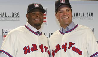 FILE - In this Jan. 7, 2016, file photo, Ken Griffey Jr., left, poses for a photograph with Mike Piazza at a press conference announcing they are both elected into the 2016 National Baseball Hall of Fame, in New York. The Seattle Mariners made Ken Griffey Jr. the first pick of the 1987 amateur draft and a year later the Dodgers selected Mike Piazza on the 62nd round with the 1,390th pick. Both left indelible imprints on the game and will be rewarded Sunday with induction into the Baseball Hall of Fame.  (AP Photo/Kathy Willens, File)