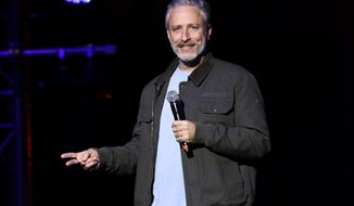 """In this Tuesday, Nov. 10, 2015, file photo, comedian Jon Stewart performs at the 9th Annual Stand Up For Heroes event, in New York. Stewart delivered a riff reminiscent of his """"Daily Show"""" days during an appearance on CBS' """"Late Show with Stephen Colbert"""" on July 21, 2016. (Photo by Greg Allen/Invision/AP, File)"""