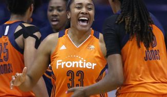 Connecticut Sun forward Morgan Tuck (33) smiles as she celebrates with Jonquel Jones, right, after the Sun defeated the Chicago Sky 94-89 in a WNBA basketball game Friday, July 22, 2016, in Rosemont, Ill. (AP Photo/Nam Y. Huh)